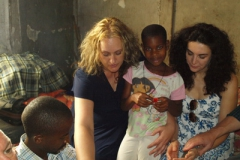 Michelle Freyre and Anne Dean visiting a sponsor child