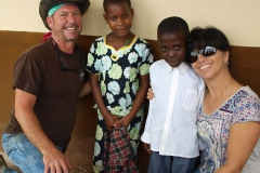 Team members Fred Kampmann and Laurie Slaughter loving on their sponsor children